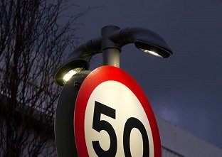Double sided Lumino City 750 LED downlight illuminating a speed change highway road sign