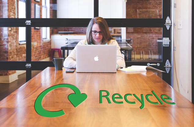 Lady in office with recycling sign