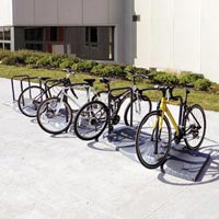 Cyclone™ Cycle Stand in Millstone with Bikes Parked