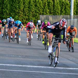 Cyclists race to the finish line in the Lewis Balyckyi Crits Series 2017