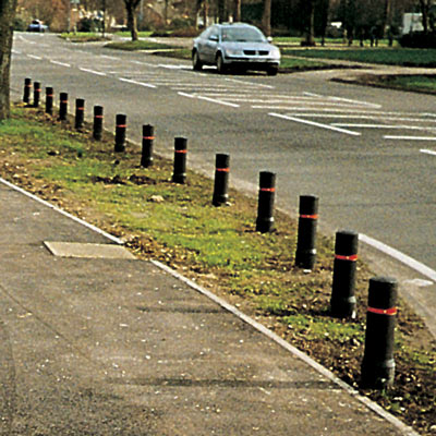 Black Edgeliner bollards with red retroreflective banding