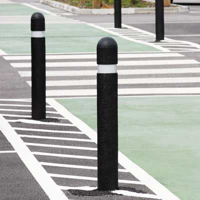 Black Round Top Enviropol bollard with white retroreflective banding - 1