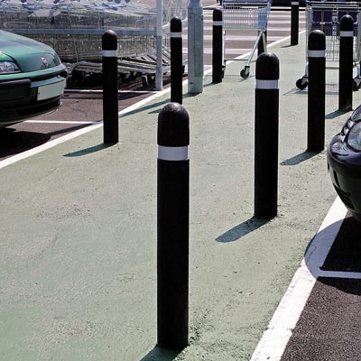 Black Round Top Enviropol bollard with white retroreflective banding