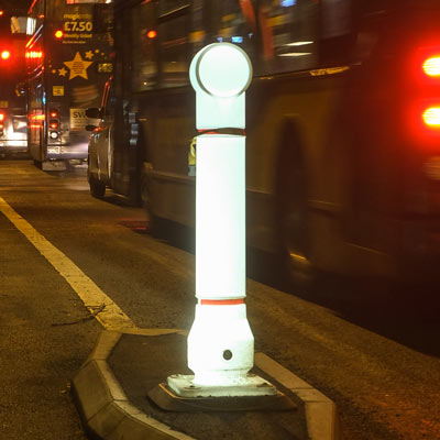 Illuminated Mini-Ensign rebound bollard helps mark the potential hazard of a traffic island at night.