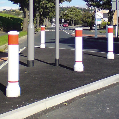 White Neopolitan 150 bollards with red/white retroreflective banding