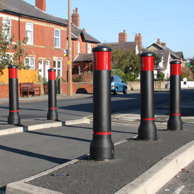 Black Neopolitan 150 bollards with red retroreflective banding